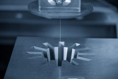 The Wire Edm Machine Cutting The Gear Shape Of Die Insert.